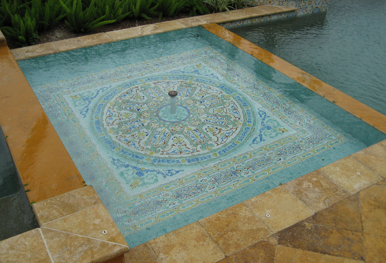 Elegant reflecting pools with hand painted Moroccan tiles
