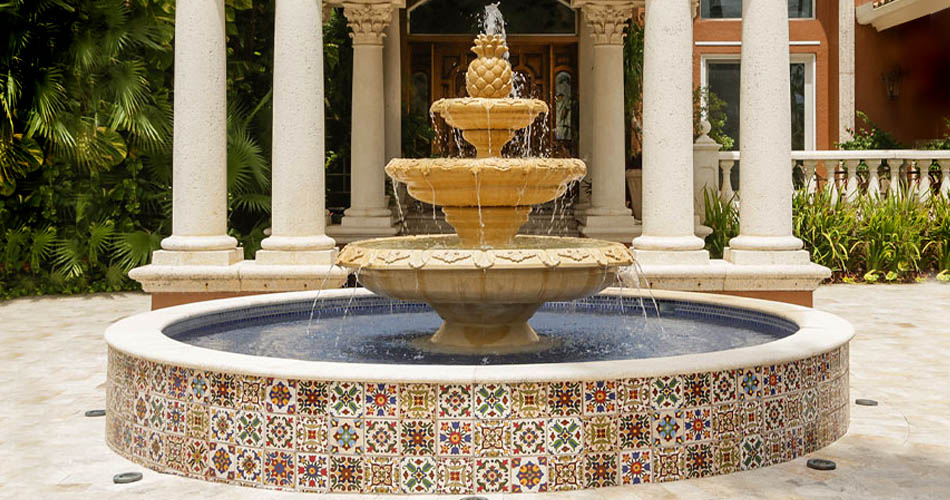 Hand painted tiles on a customized fountain in an elegant courtyard.
