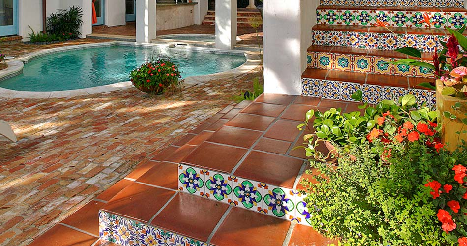 Hand painted stair risers in a Mediterranean courtyard.